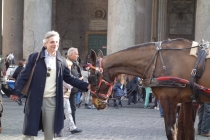 Outside Pantheon man with horse