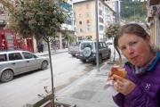 Enjoying a local snack in Berat