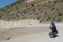 Cycling up steep gravel road