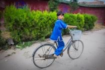 Wushu practising boy on bike