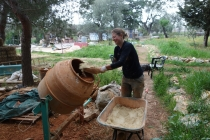 Putting sand into the plastering mix