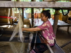 Woman weaving in village