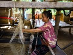 Woman weaving in village