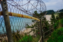 Barb wire along many beaches