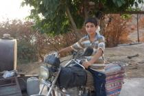 Amin on motorbike