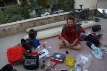 Robin with all his stuff spread out on the rooftop