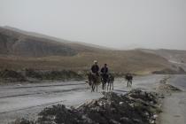 Kids on donkeys following us