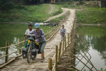 Assam, crossing rivers on bamboo