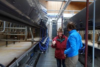 Martin and senior looking at the milk machine